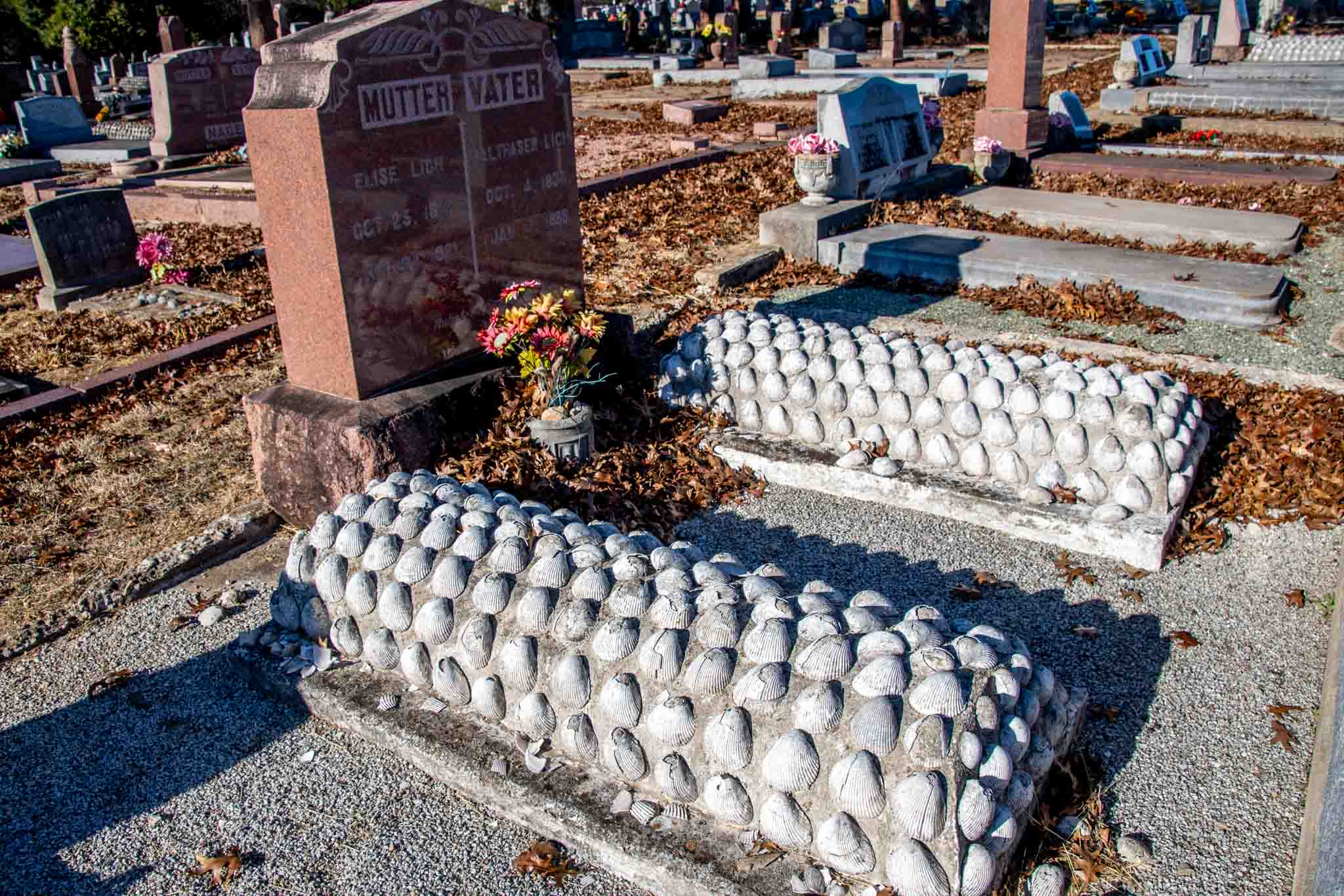 Two graves covered in scallop seashells