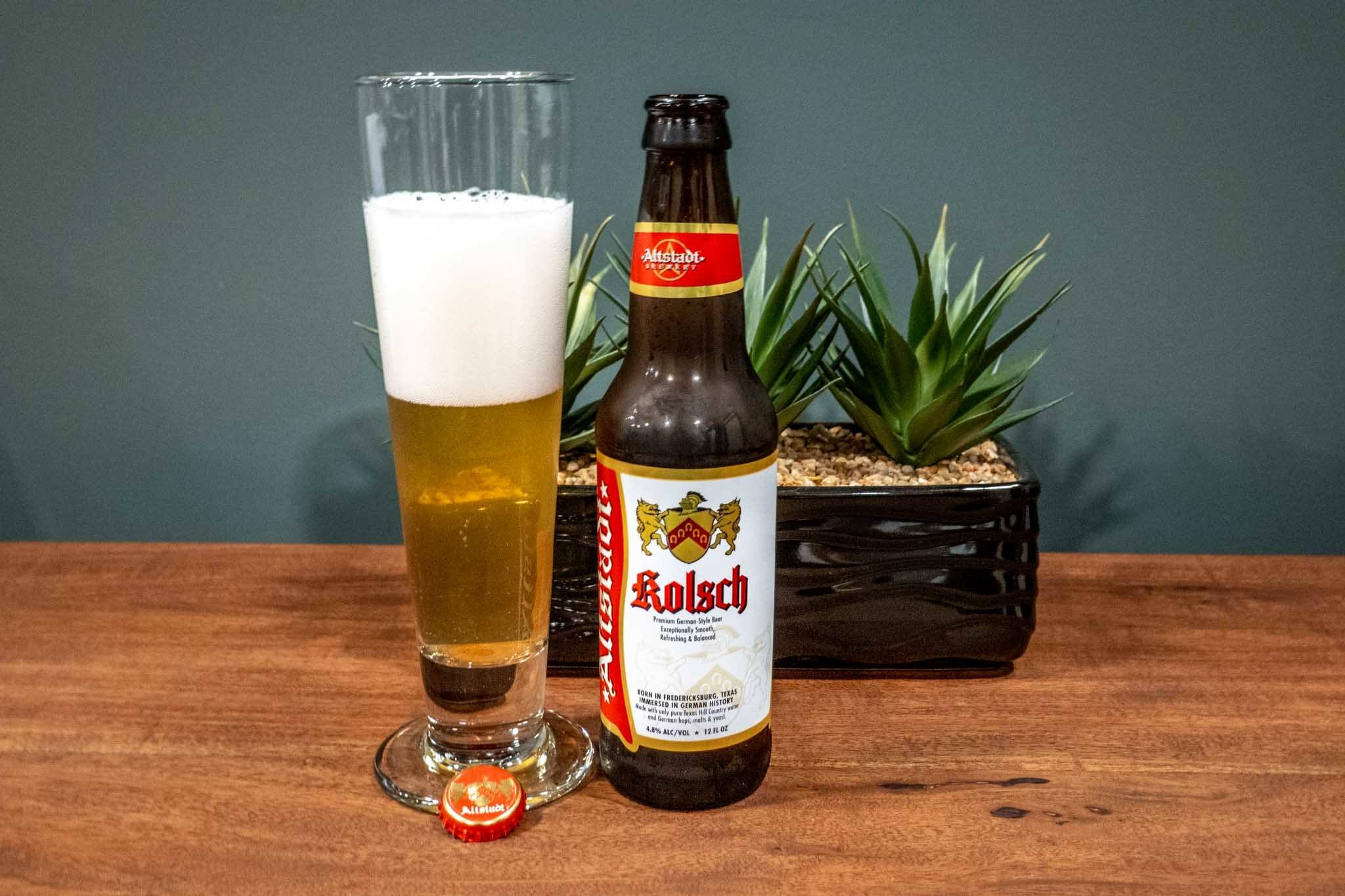 Glass and bottle of Kolsch beer on table