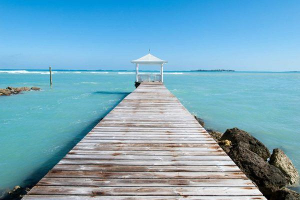 Pier sticking out into the blue ocean
