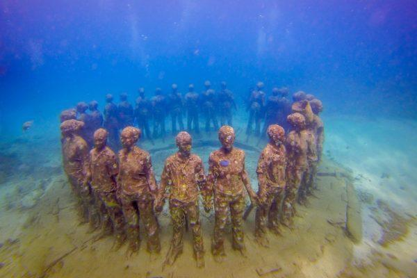 Statues in a circle underwater