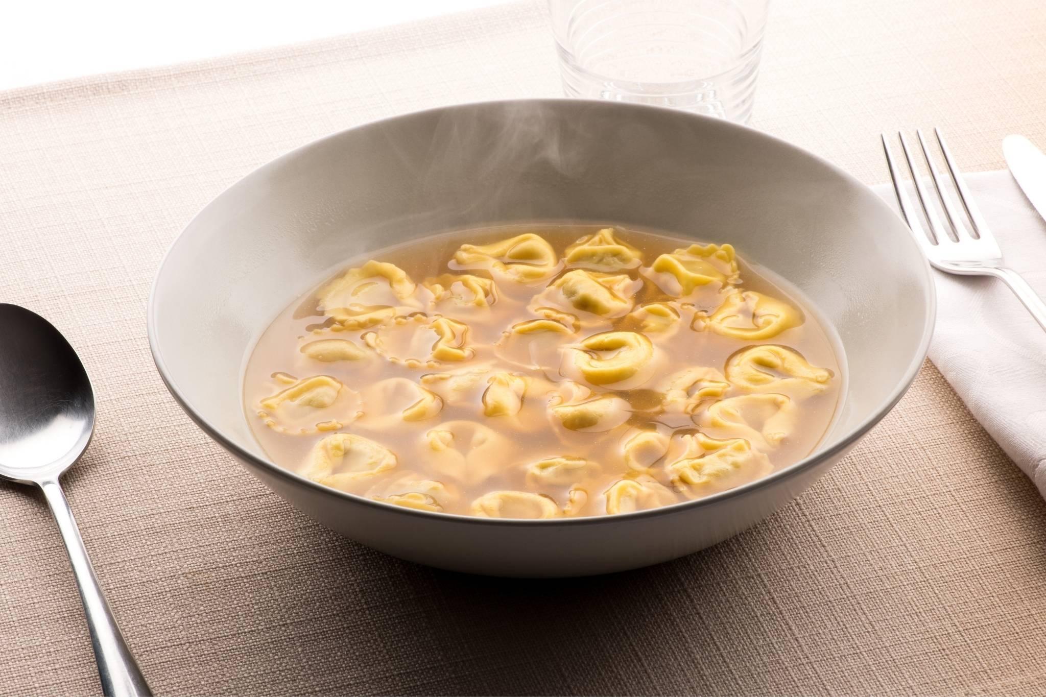Bowl of tortellini pasta in broth