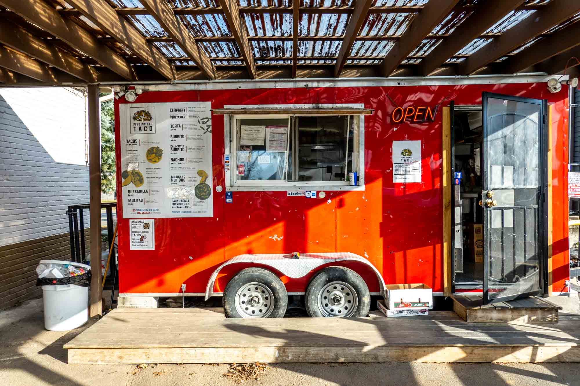 Red food truck with a menu on its side