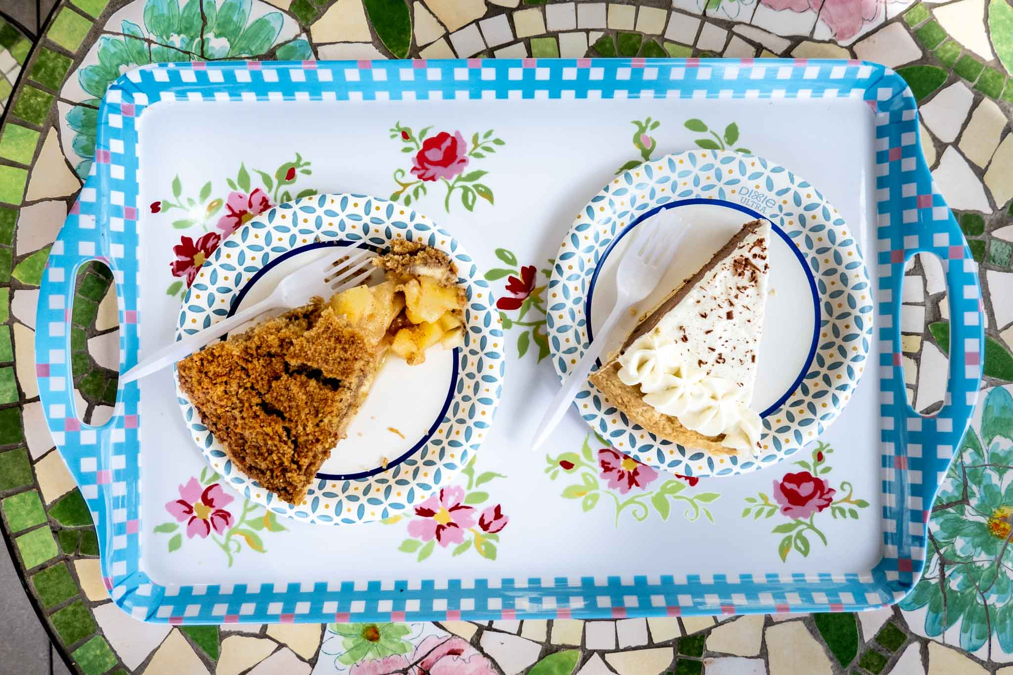 Two slices of pie on a colorful tray