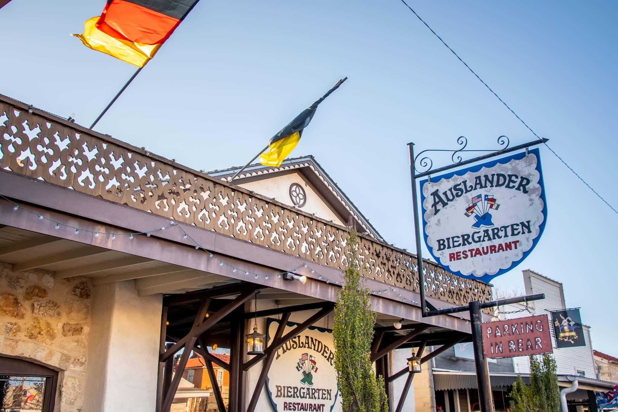 Exterior of a restaurant with sign: Auslander Biergarten Restaurant