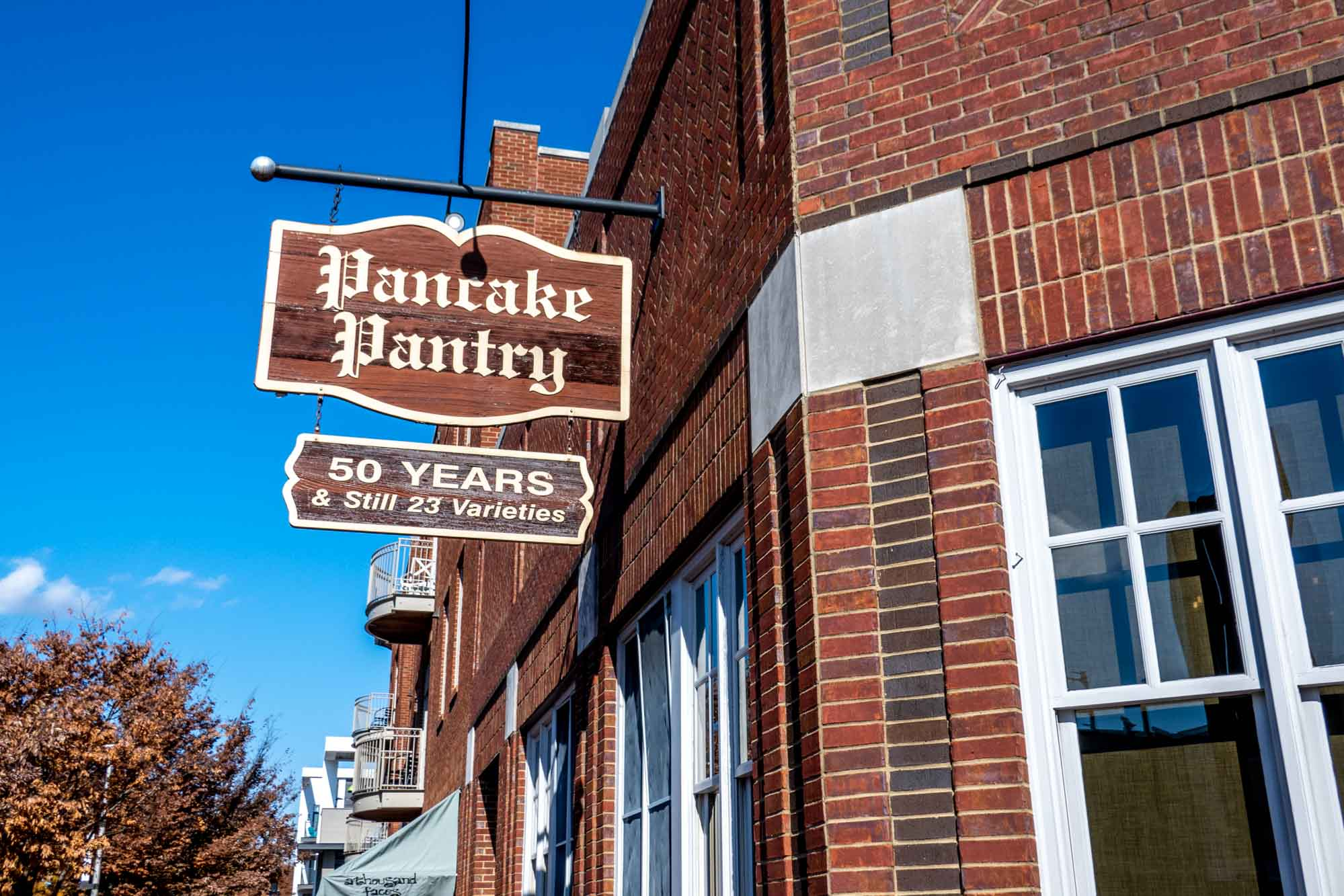 Sign outside a brick building: Pancake Pantry, 50 Years & Still 23 Varieties