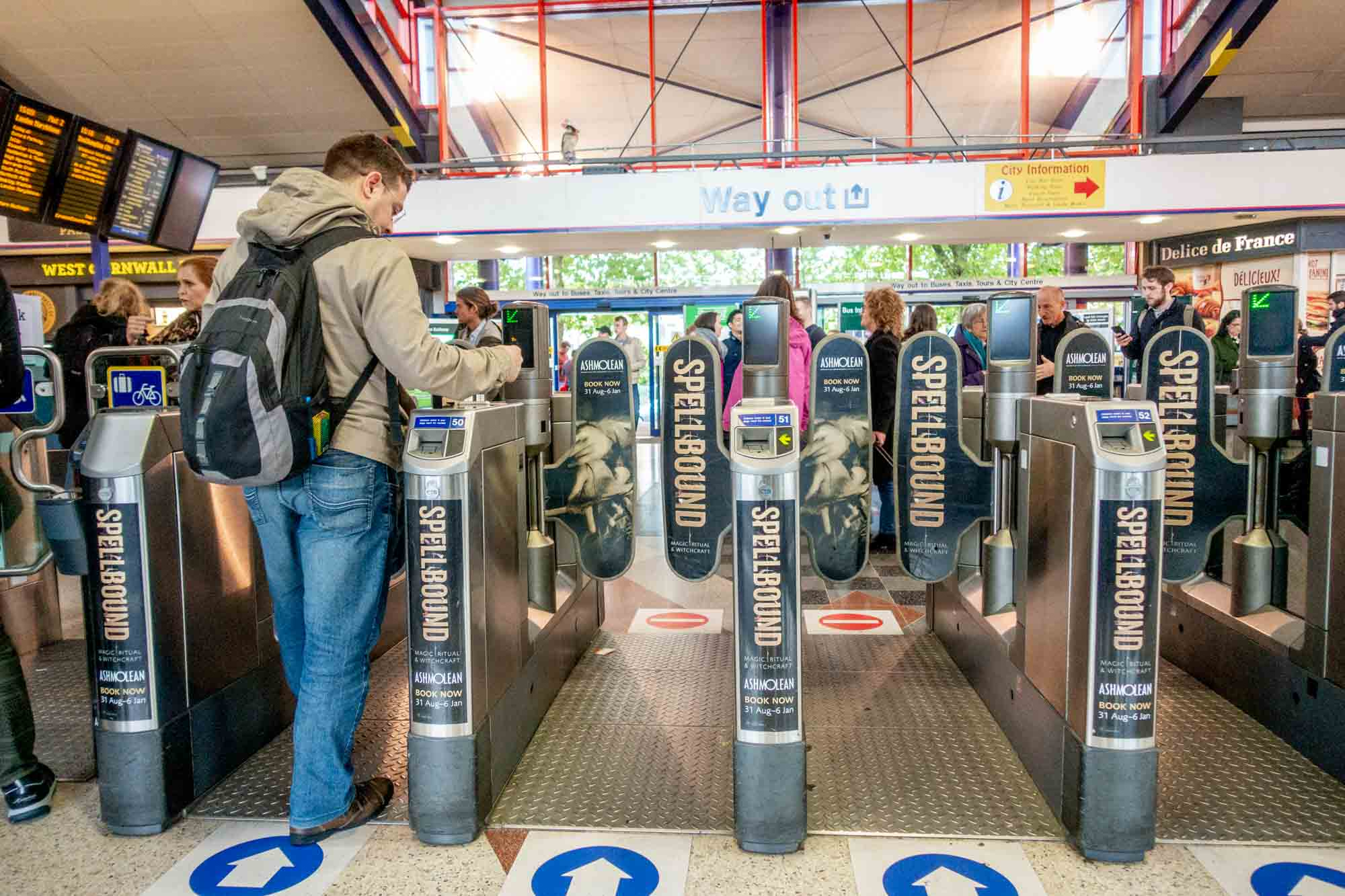 Man passing through turnstiles in a train station