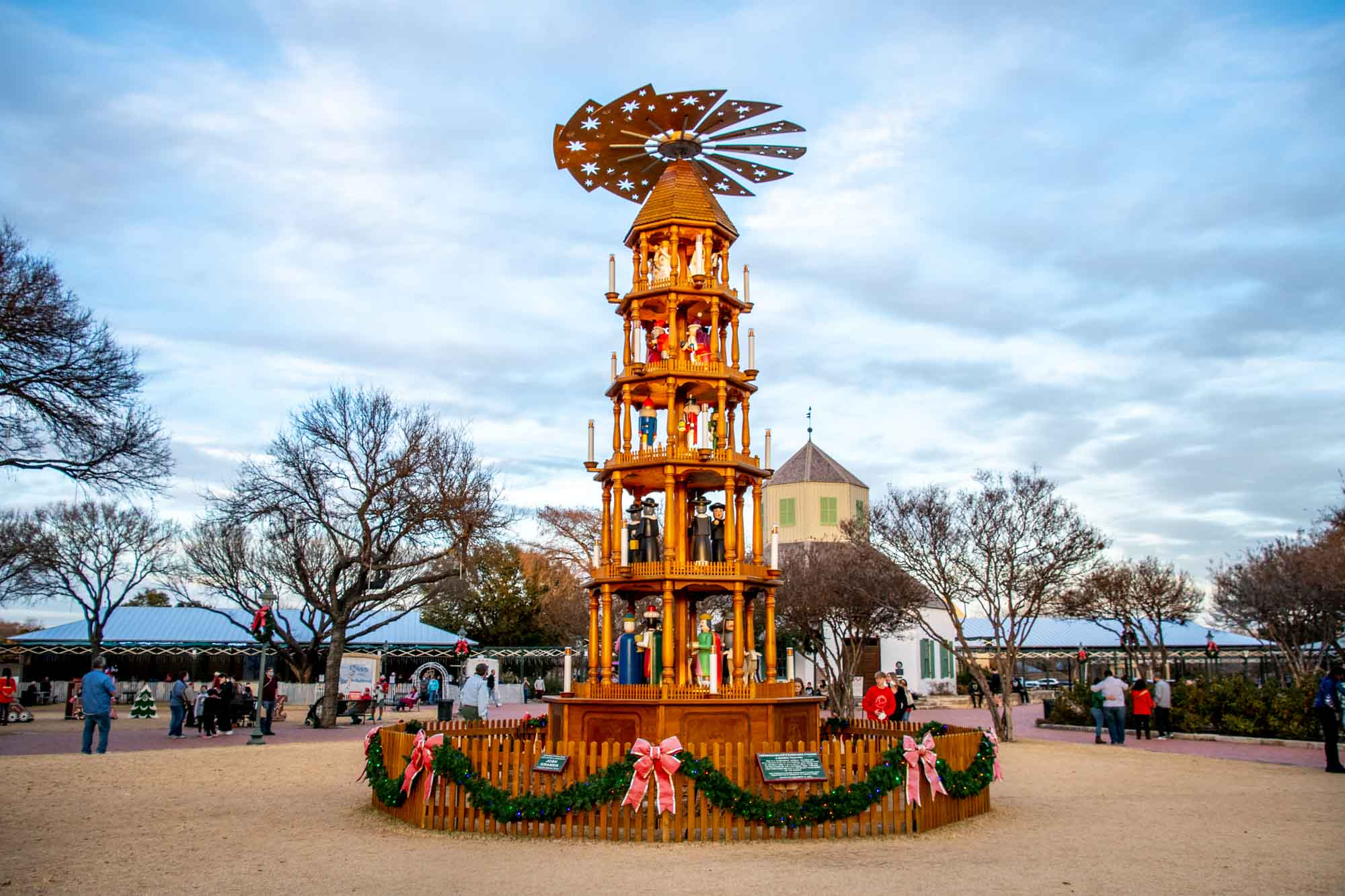 Tall, wooden German Christmas pyramid with a propeller displayed outside
