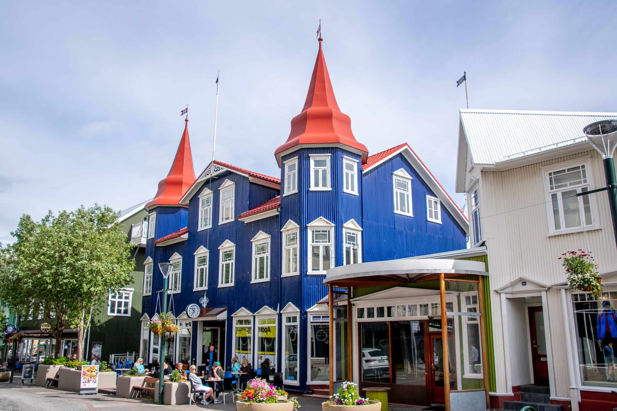 Blue building with red roof on main street in Akuryeri