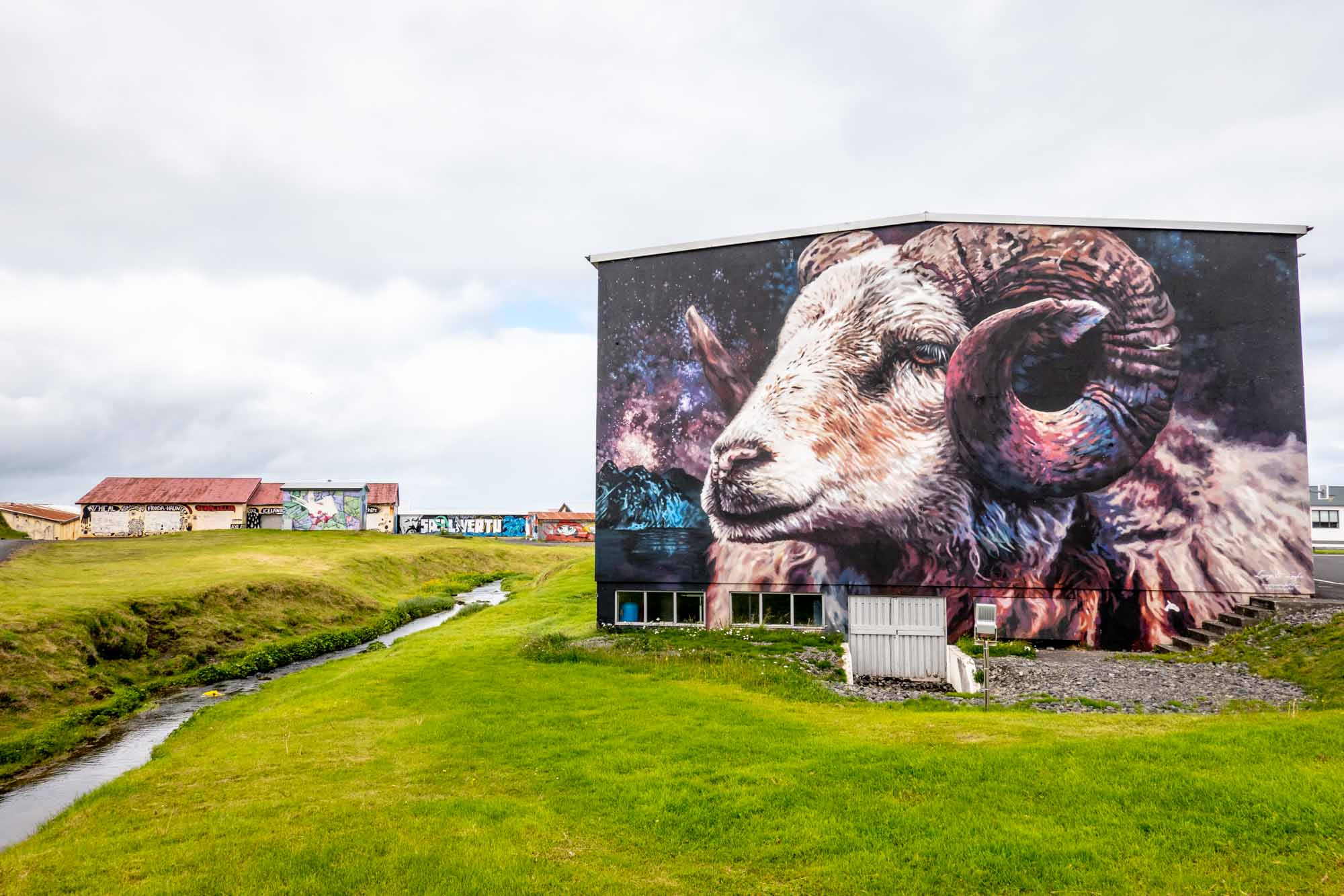 Mural of a ram with horns on side of a building