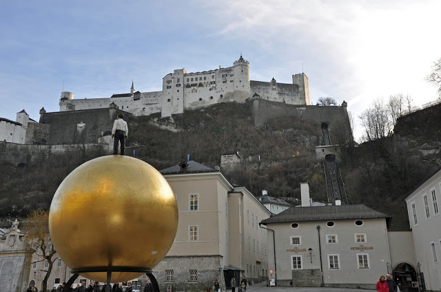 View of the Fortress from Salzburg's Main Square with gold ball sculpture