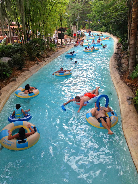 People in inner tubes floating in a lazy river