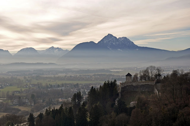 A hazy view of Salzburg and the mountains from the Hohensalzburg Fortress