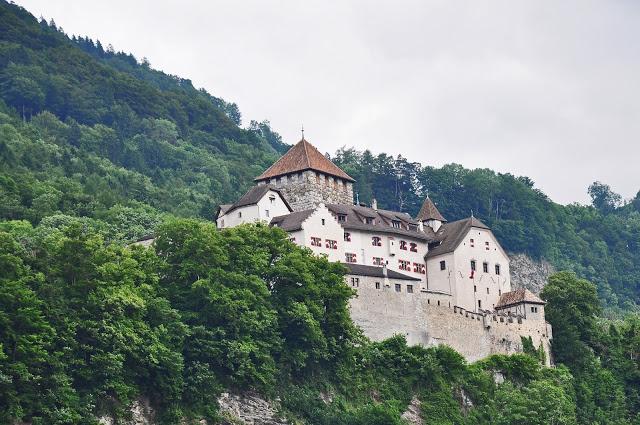 Visit Liechtenstein to see the stone castle on a hillside in Vaduz