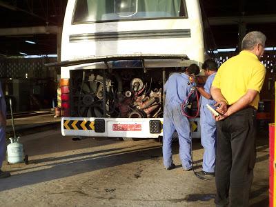Mechanics working on a broken down Mwasalat Bus