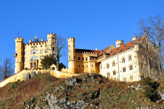 Yellow exterior of Hohenschwangau Castle on the hilltop