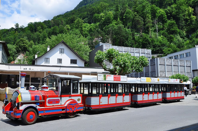 Red and gray city tourist train in Vaduz