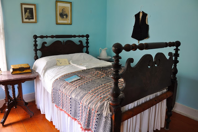 A bedroom in the LaPorte House in period decoration