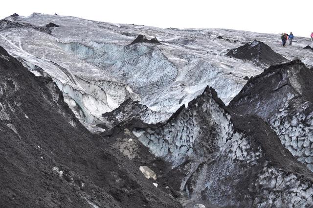 People walking on Solheimajokull Glacier